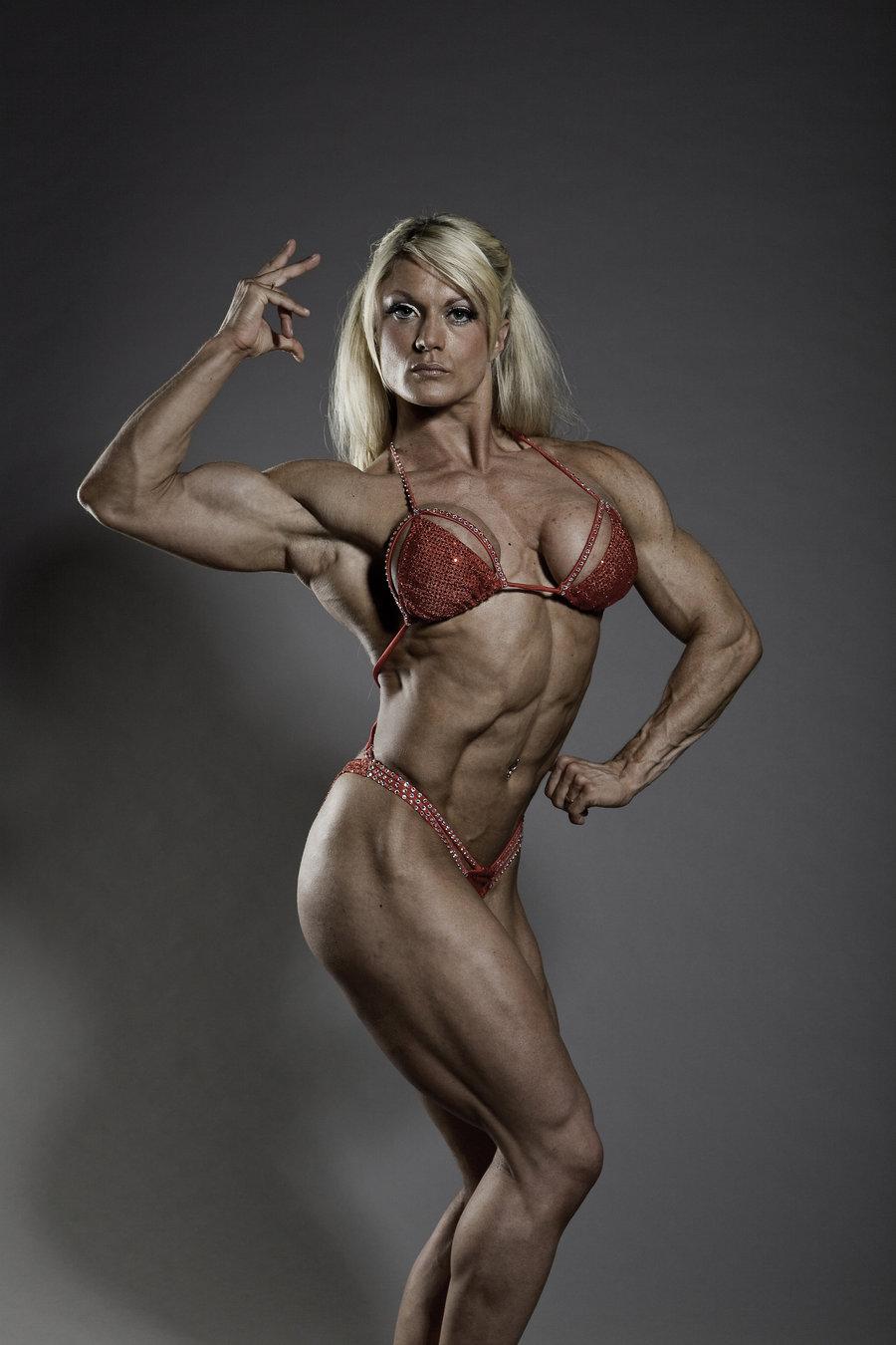 huge female bodybuilder lisa cross flexing her muscles